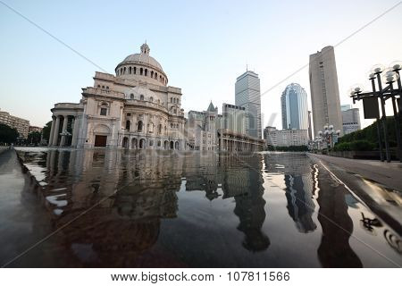 USA, BOSTON - SEP 06, 2014: Complex of Christian Science Center with Mary Baker Eddy Library and Mother Church near pond at autumn morning.