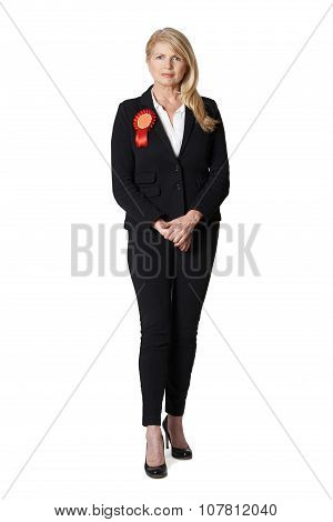 Full Length Portrait Of Female Politician Wearing Red Rosette