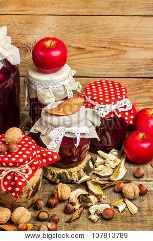 Autumn Preserved Fruits And Vegetables On A Rustic Table