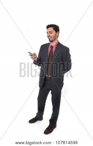 Corporate Portrait Of Young Attractive Businessman Of Latin Hispanic Ethnicity Smiling Using Mobile