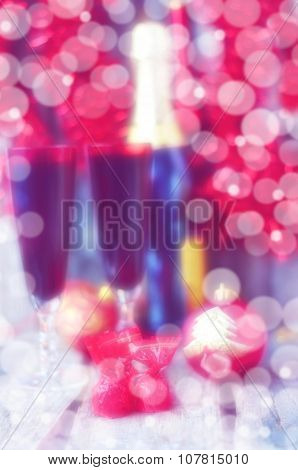 Christmas still life with bottle of champagne and two glasses blured photo Happy New Year background
