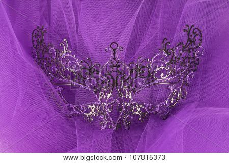 Colorful Venetian Face Mask on Purple Tulle Fabric
