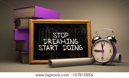 Stop Dreaming, Start Doing. Inspirational Quote on Chalkboard.