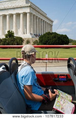 USA, NEW-YORK - AUG 30, 2014: Boy is going near Great Lincoln Memorial by bus.