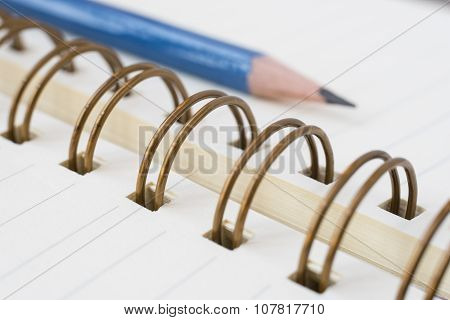 Ring binder notebook with pencil.
