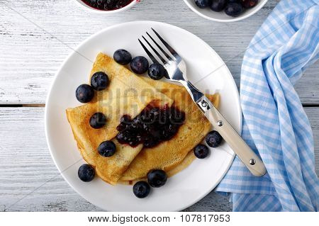Crepes With Fresh Berries And Jam On A Plate