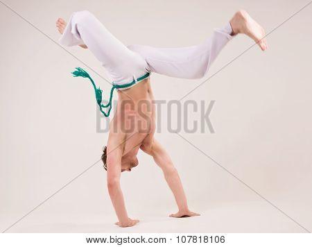 Capoeira Dancer On White Background