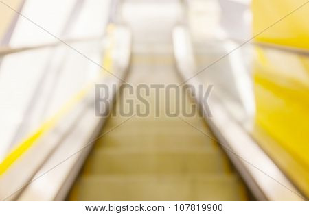 Abstract Blurred Background Of Looking Down View Escalator In An Office Building.
