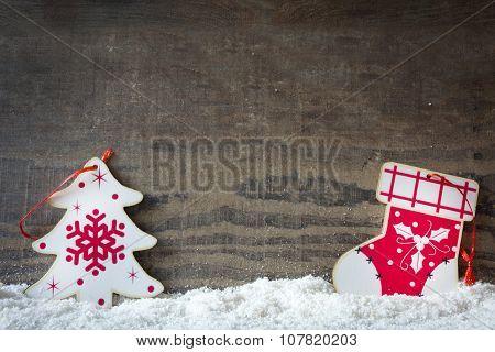 Christmas tree and Christmas sock on snow and wood background