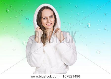 Young woman in white bathrobe