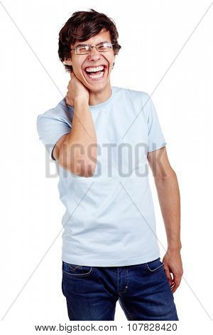 Portrait of young hispanic man wearing glasses, blue t-shirt and jeans standing with hand behind his neck and loudly laughing isolated on white background - laughter concept