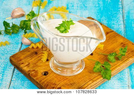 Sour Cream Sauce With Spices In A Glass Gravy Boat
