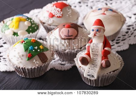Fabulous Christmas Cupcakes With Decorations Closeup. Horizontal