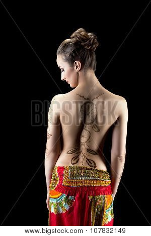 Mehendi. Shot of woman's back painted with henna