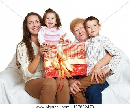 happy family with box gift, woman with child and senior - holiday concept