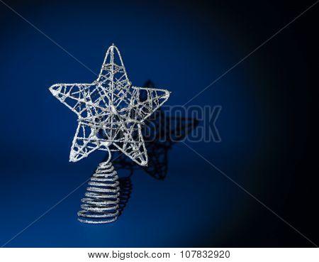 Christmas star on blue background, hard light