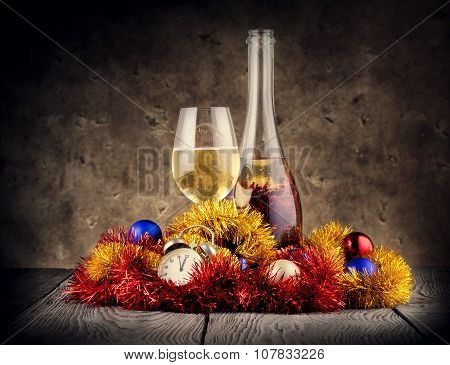 Christmas still life with champagne and clock