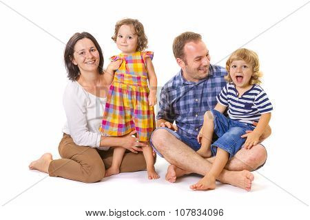 Happy Family of Four Smiling
