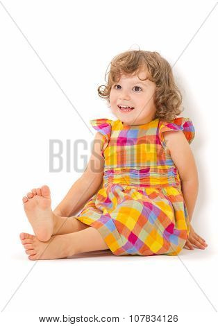 Cute Little Girl Sitting on Floor