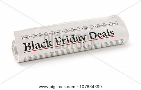 Rolled Newspaper With The Headline Black Friday Deals