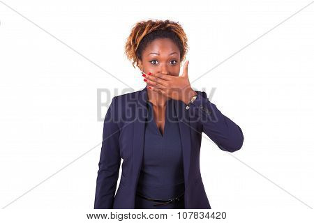 African American Business Woman Hiding Her Mouth With Her Hand