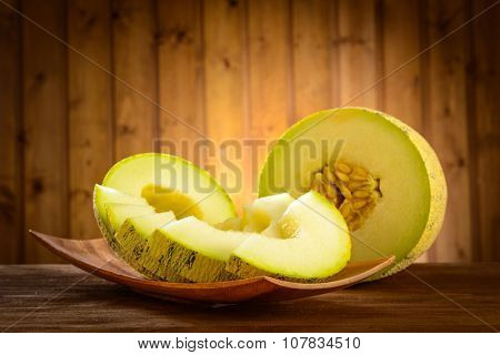 cantaloupe melon on the wooden background