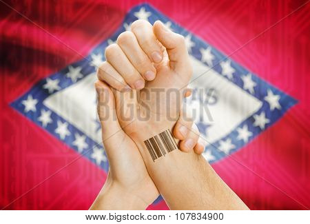 Barcode Id Number On Wrist And Usa States Flags On Background - Arkansas