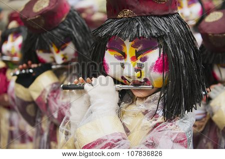 Women play flutes at Basel Carnival in Basel, Switzerland. Daytime Procession At Basler Fasnacht.