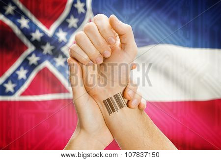 Barcode Id Number On Wrist And Usa States Flags On Background - Mississippi