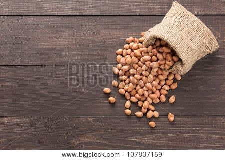 Peanut In Sacks On The Wooden Background