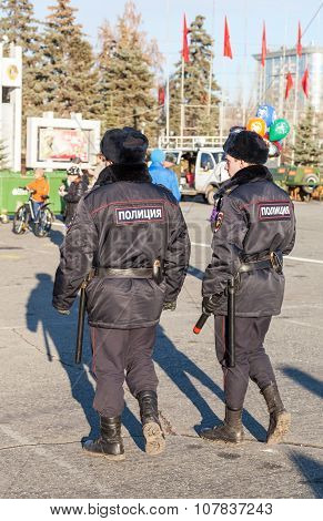 Police Patrol At The Central Square In  Sunny Day