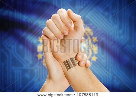 Barcode Id Number On Wrist And Usa States Flags On Background - New Hampshire