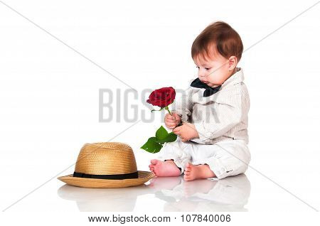 Little One Old Year  Boy With  Hat And Red Rose Sitting On White Background. Retro, Vintage