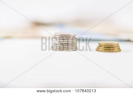 Business, Finance, Investment, Saving And Cash Concept - Close Up Of Euro Paper Money And Coins On T