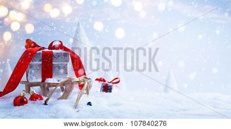 Art Santa's Sleigh With Christmas Gifts On The Background Of Snowy Trees