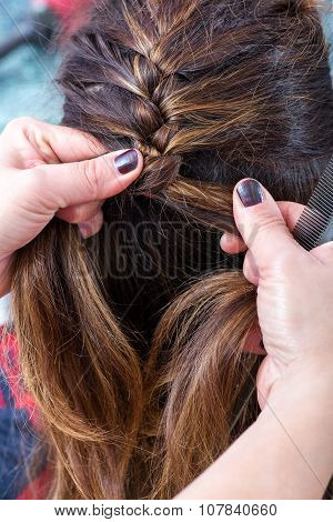 Hairstylist Braiding The Brown Hair Of A Woman