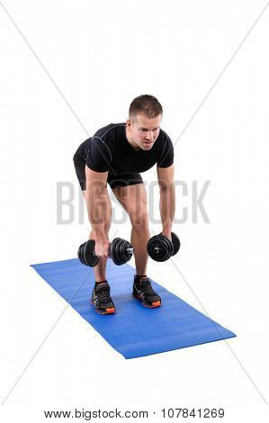 Young man shows starting position of Standing Bent Over Dumbbell Reverse Fly workout, isolated on white