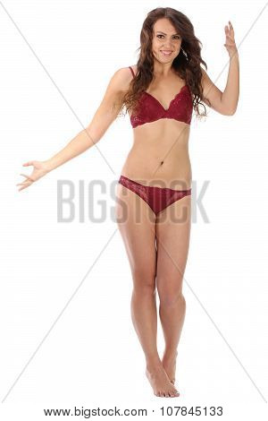 Beautiful full body brunette beauty woman in red sexy underwear, isolated on white