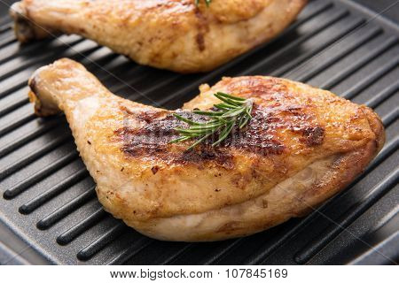 Grilled Chicken Lag And Rosemary In A Pan