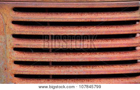 Rusty old truck grill background