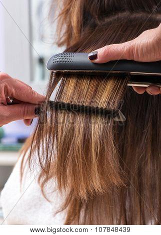 Hairdresser Using A Hair Straightener