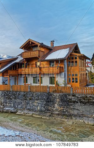 Exterior view of the traditional wooden Alpine chalet in Garmisch-Partenkirchen on a beautiful winter day. Bavaria. Germany.