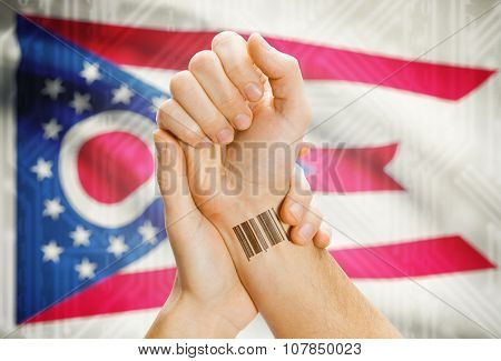 Barcode Id Number On Wrist And Usa States Flags On Background - Ohio