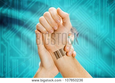 Barcode Id Number On Wrist And Usa States Flags On Background - Oklahoma