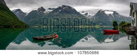 Boats And Reflection In The Water In Panorama