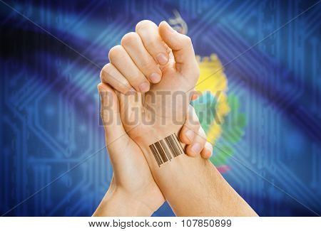Barcode Id Number On Wrist And Usa States Flags On Background - Vermont