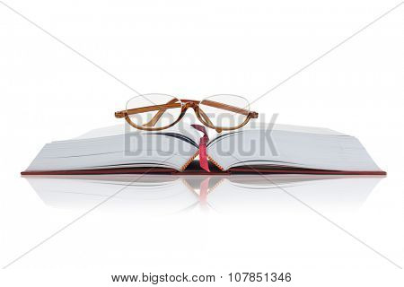 Reading Glasses on an Open Hardcover Book With Copy Space