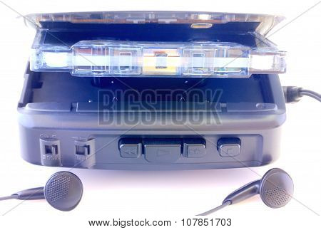 Walkman and audio tape isolated on white
