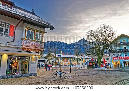 GARMISCH-PARTENKIRCHEN GERMANY - JANUARY 06 2015: View of the street in Garmisch-Partenkirchen an idyllic mountain resort in the valleys of the Bavarian Alps beneath the towering Zugspitze peak