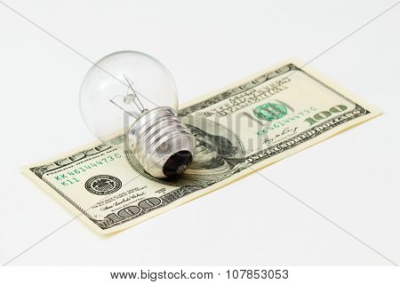 Little Light Bulb Is Laying On Money